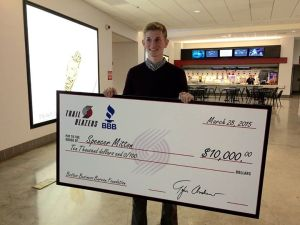 Spencer Mitton with his $10,000 scholarship check from BBB Foundation.
