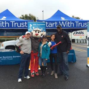 BBB staff with Jerome Kersey and Blaze the Trail Cat at BBB Secure Your ID Day in October 2014.